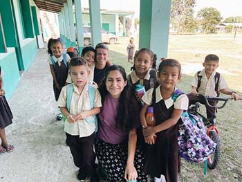 C of O student with children in Belize