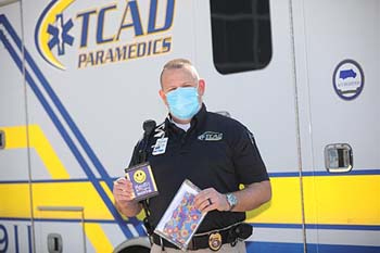 "C of O delivers 100 handmade ""Mynette's Legacy Masks"" to the local TCAD in Hollister, Missouri. Additional deliveries are planned for the Branson fire and police departments and Cox Medical Center. Jeff Hawkins, EMT-P and deputy chief of operations, receives the gift of masks from College of the Ozarks."