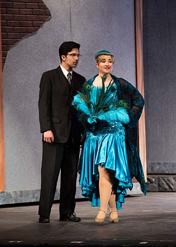 "Christian Belcher, as Mr. Boddy, performs alongside Anna Brayman, as Mrs. Peacock, in ""Clue the Musical."""